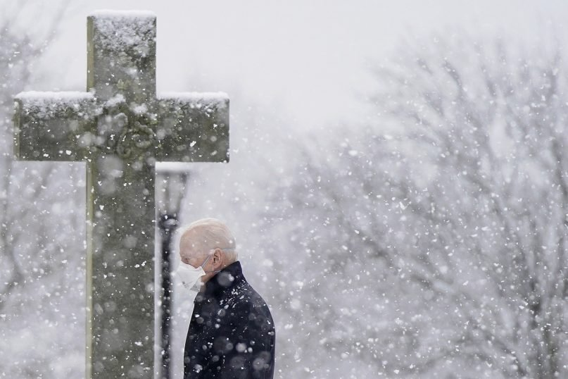 President Joe Biden departs after attending Mass at St. Joseph on the Brandywine Catholic Church as snow falls, Sunday, Feb. 7, 2021, in Wilmington, Del. President Biden is tasked with selecting a new ambassador to the Holy See to recommend to the Senate for confirmation. (AP Photo/Patrick Semansky)