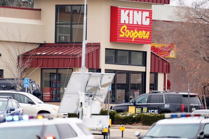 Police work on the scene outside of a King Soopers grocery store where a shooting took place March 22, 2021, in Boulder, Colorado. (AP Photo/David Zalubowski)