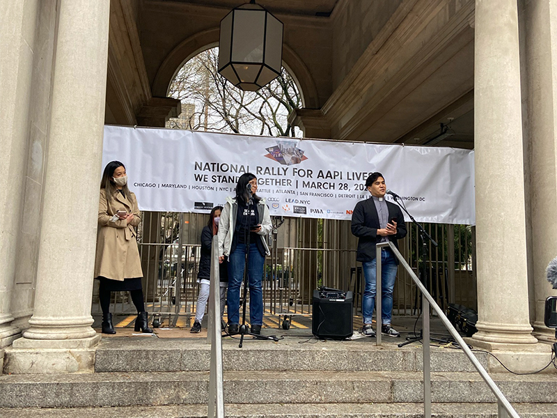 Pastor Reyn Cabinte, right, speaks during a National Rally for AAPI Lives and Dignity event in Manhattan's Union Square, Sunday, March 28, 2021, in New York. RNS photo by Roxanne Stone