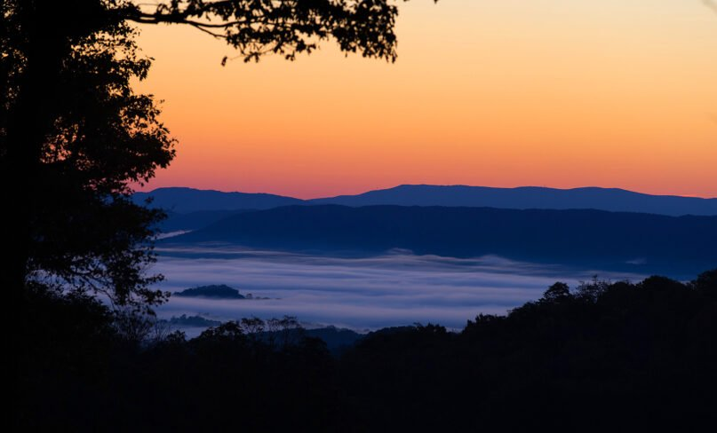 The sun rises over the fog-shrouded Shenandoah Valley just off the Appalachian Trail near Pearisburg, Va. Photo by Mike DuBose/UMNS