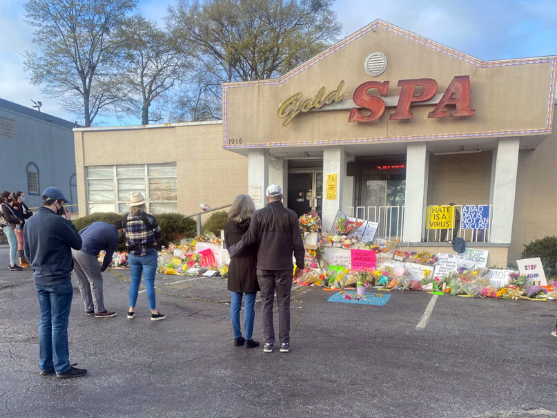 People gather at Gold Spa during a prayer walk between two spas involved in recent shootings, March 21, 2021, in Atlanta. Photo by Maina Mwaura