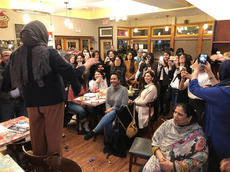 Bushra Amiwala talks with a group of friends and family after winning her election in April, 2019. Image courtesy of Bushra Amiwala's twitter