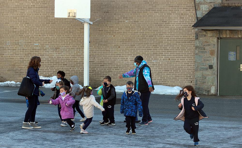 Children run around the playground at St. Agnes School in West Chester, Pennsylvania, Feb. 24, 2021. RNS photo by Elizabeth Evans