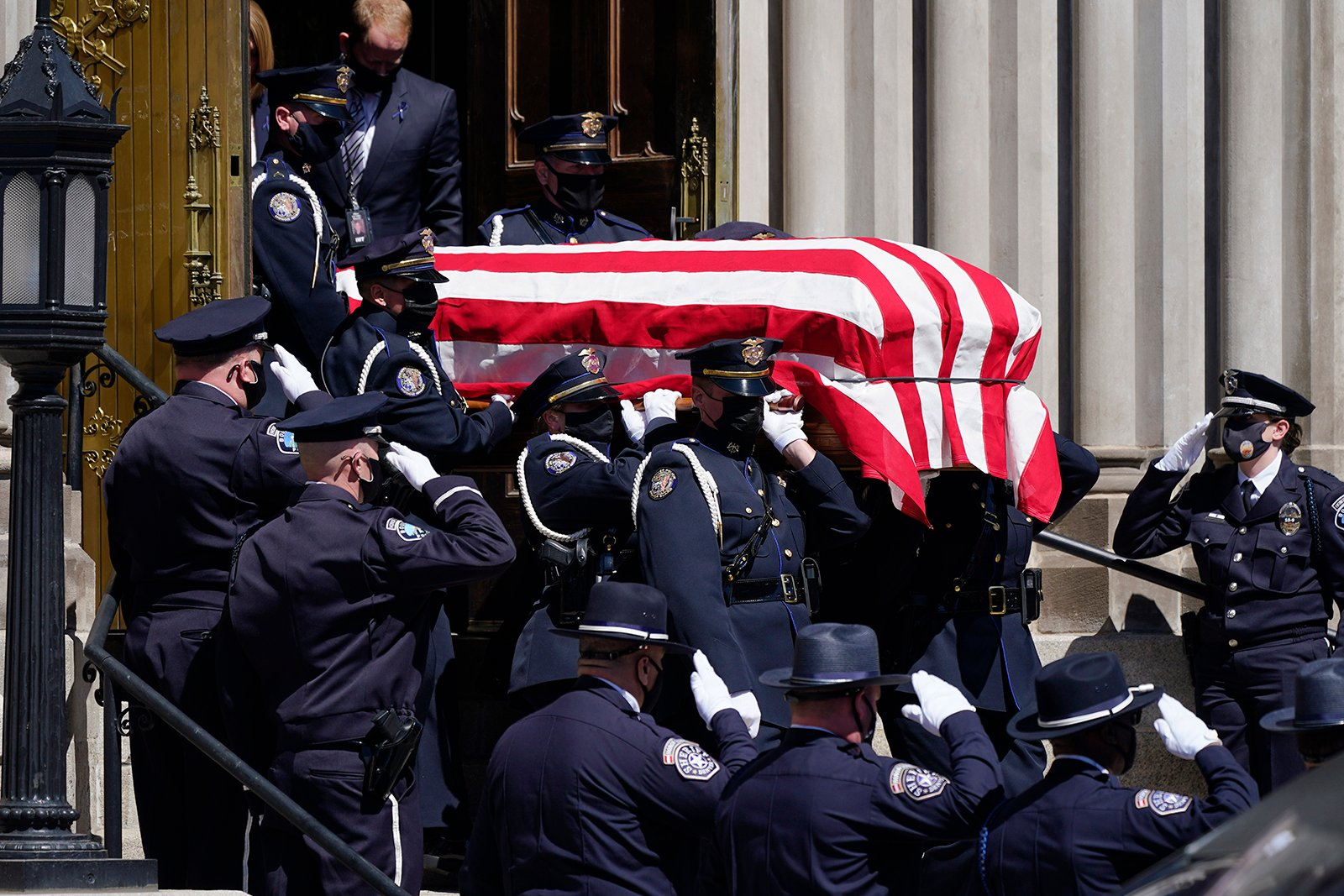 The casket carrying the body of fallen Boulder, Colo., Police Department officer Eric Talley is carried by a Denver Police honor guard to a waiting hearse after a service at the Cathedral Basilica of the Immaculate Conception, Monday, March 29, 2021, in Denver. Talley and nine other people were killed on Monday, March 22, during a mass shooting at a grocery store in Boulder. (AP Photo/David Zalubowski)