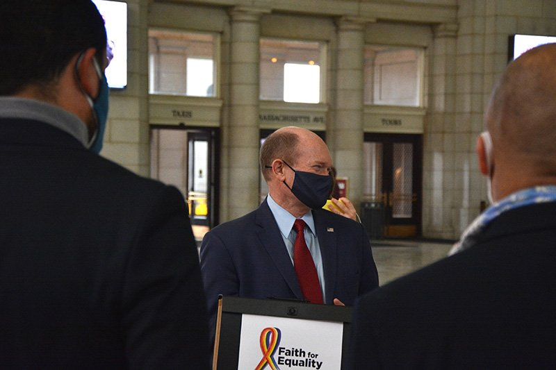 Sen. Chris Coons (D-DE) accepts a group of petitions from faith leaders in support of the Equality Act, Tuesday, March 16, 2021, in Washington D.C.'s Union Station. RNS photo by Jack Jenkins