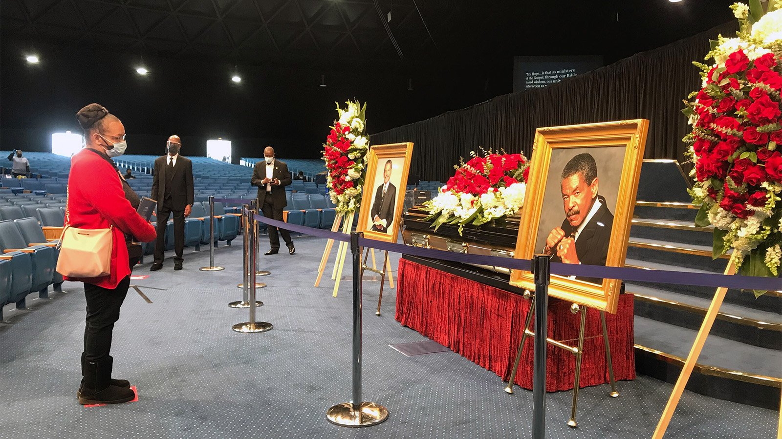 """Judy Venable, left, pays her respects to the late Rev. Frederick K.C. """"Fred"""" Price during a public viewing Thursday, March 4, 2021, at FaithDome in Los Angeles. RNS photo by Alejandra Molina"""
