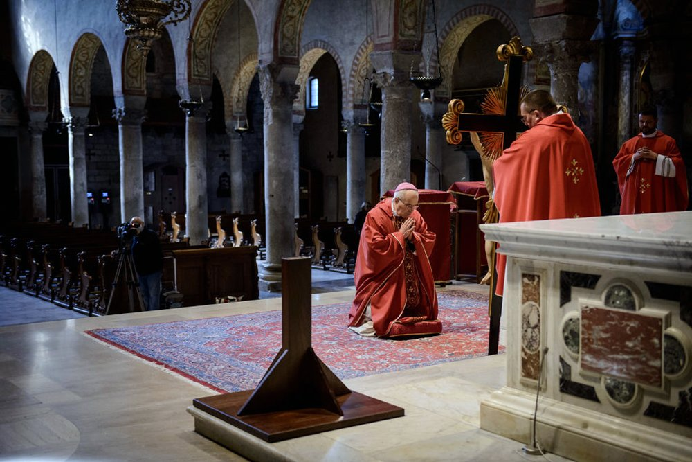 The Veneration of the Cross is celebrated on Good Friday in an empty Cathedral of San Giusto due to the coronavirus lockdown, on April 10, 2020, in Trieste, Italy. (Photo by Jacopo Landi/NurPhoto via Getty Images)