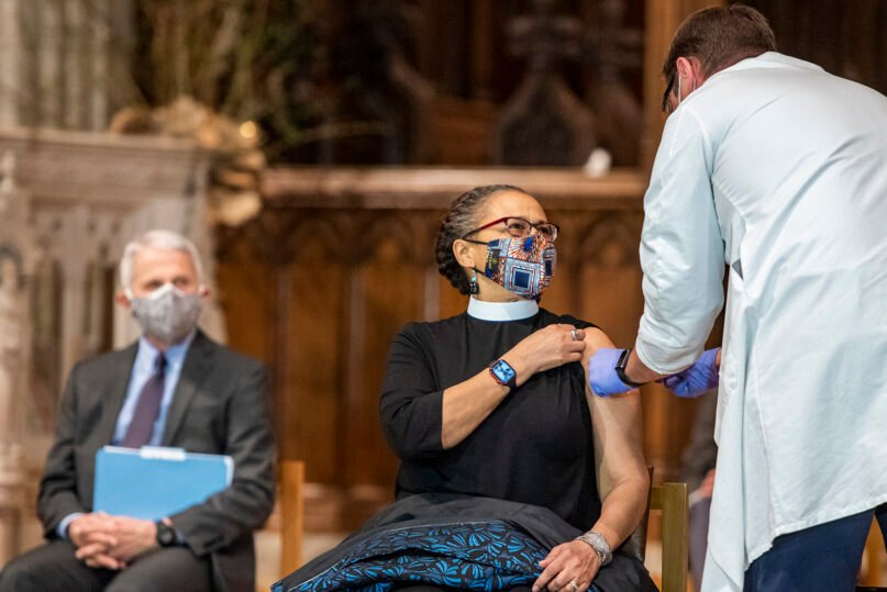 The Rev. Patricia Hailes Fears, pastor of the Fellowship Baptist Church in Washington, receives the Johnson & Johnson COVID-19 vaccine during a gathering of a group of interfaith clergy members, community leaders and officials at the Washington National Cathedral, to encourage faith communities to get the COVID-19 vaccine, Tuesday, March 16, 2021, in Washington. Photo by Danielle E. Thomas/Washington National Cathedral