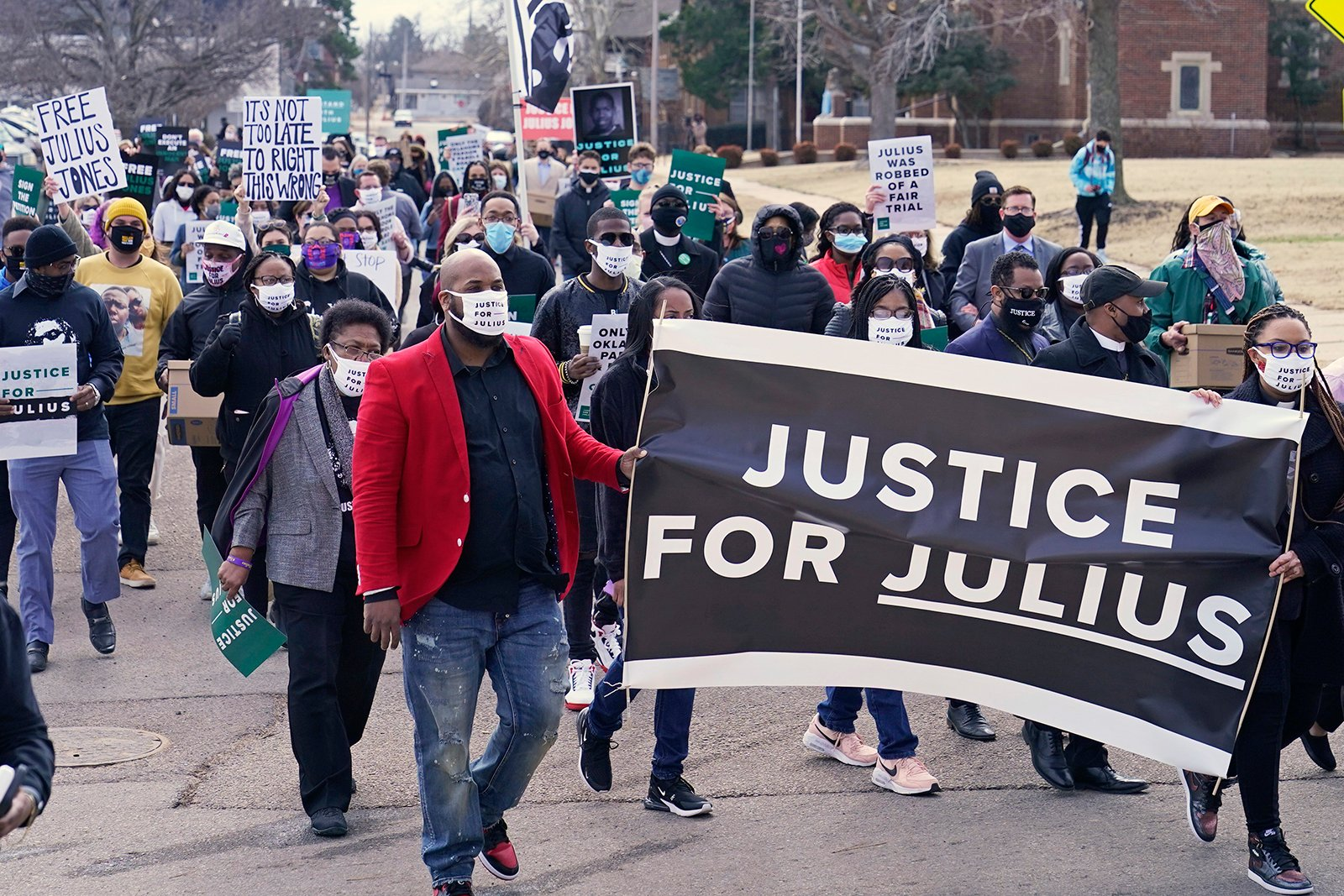 Supporters of Julius Jones, who has been on death row in Oklahoma for two decades, march to the offices of the Oklahoma Pardon and Parole Board, Thursday, Feb. 25, 2021, in Oklahoma City, where they presented a petition with over 6.2 million signatures, calling for Jones' death sentence to be commuted. (AP Photo/Sue Ogrocki)