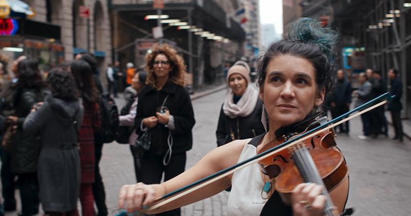 "Alicia Jo Rabins plays the violin in a scene from ""A Kaddish for Bernie Madoff."" Photo courtesy of A Kaddish for Bernie Madoff"