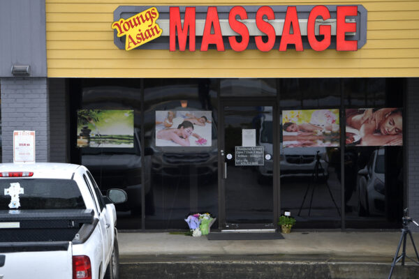 A makeshift memorial is seen outside a business where a multiple fatal shooting occurred on Tuesday, March 16, 2021, in Acworth, Ga. Robert Aaron Long, a white man, is accused of killing several people, most of whom were of Asian descent, at massage parlors in the Atlanta area. (AP Photo/Mike Stewart)