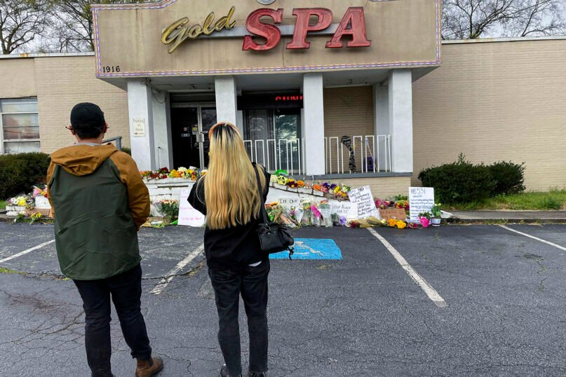People view a makeshift memorial on Friday, March 19, 2021, in Atlanta.  Robert Aaron Long, a white man, is accused of killing several people, most of whom were of Asian descent, at massage parlors in the Atlanta area. (AP Photo/Candice Choi)