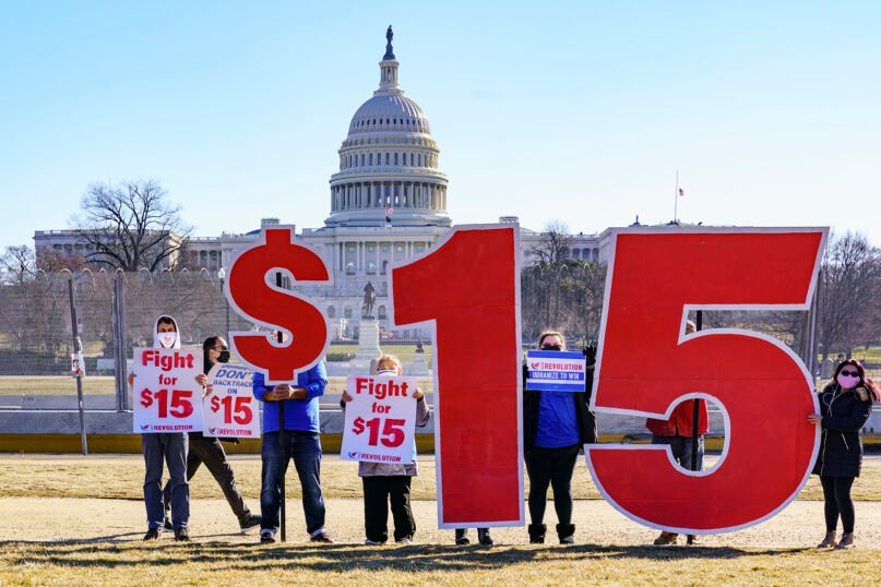 Activists appeal for a $15 minimum wage near the Capitol in Washington, Thursday, Feb. 25, 2021. (AP Photo/J. Scott Applewhite)