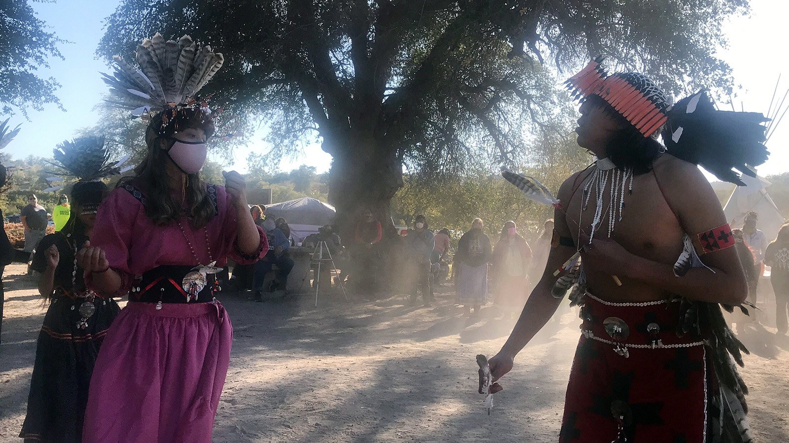Waya Brown, from right, Gouyen Lopez-Brown and Lozen Lopez-Brown dance and bless the land at Oak Flat campground on Saturday, Feb. 27, 2021, in Arizona's Tonto National Forest, roughly 70 miles east of Phoenix. RNS photo by Alejandra Molina