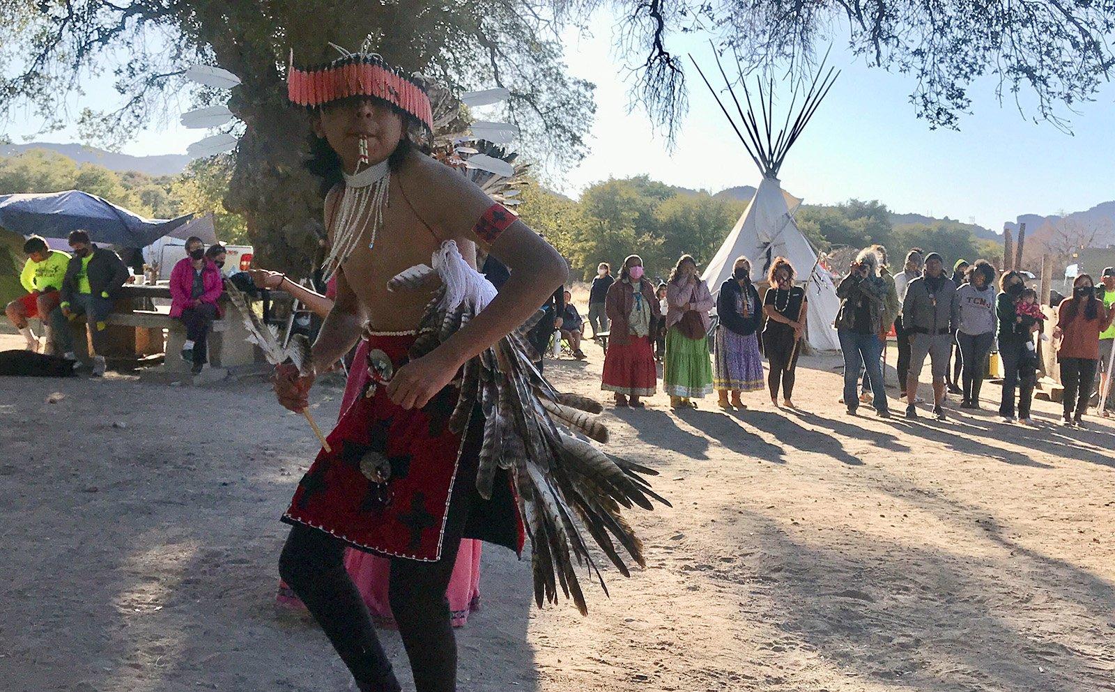 Waya Brown, who is Apache and Pomo, dances in a circle at Oak Flat campground on Saturday, Feb. 27, 2021, near Superior, Arizona. RNS photo by Alejandra Molina