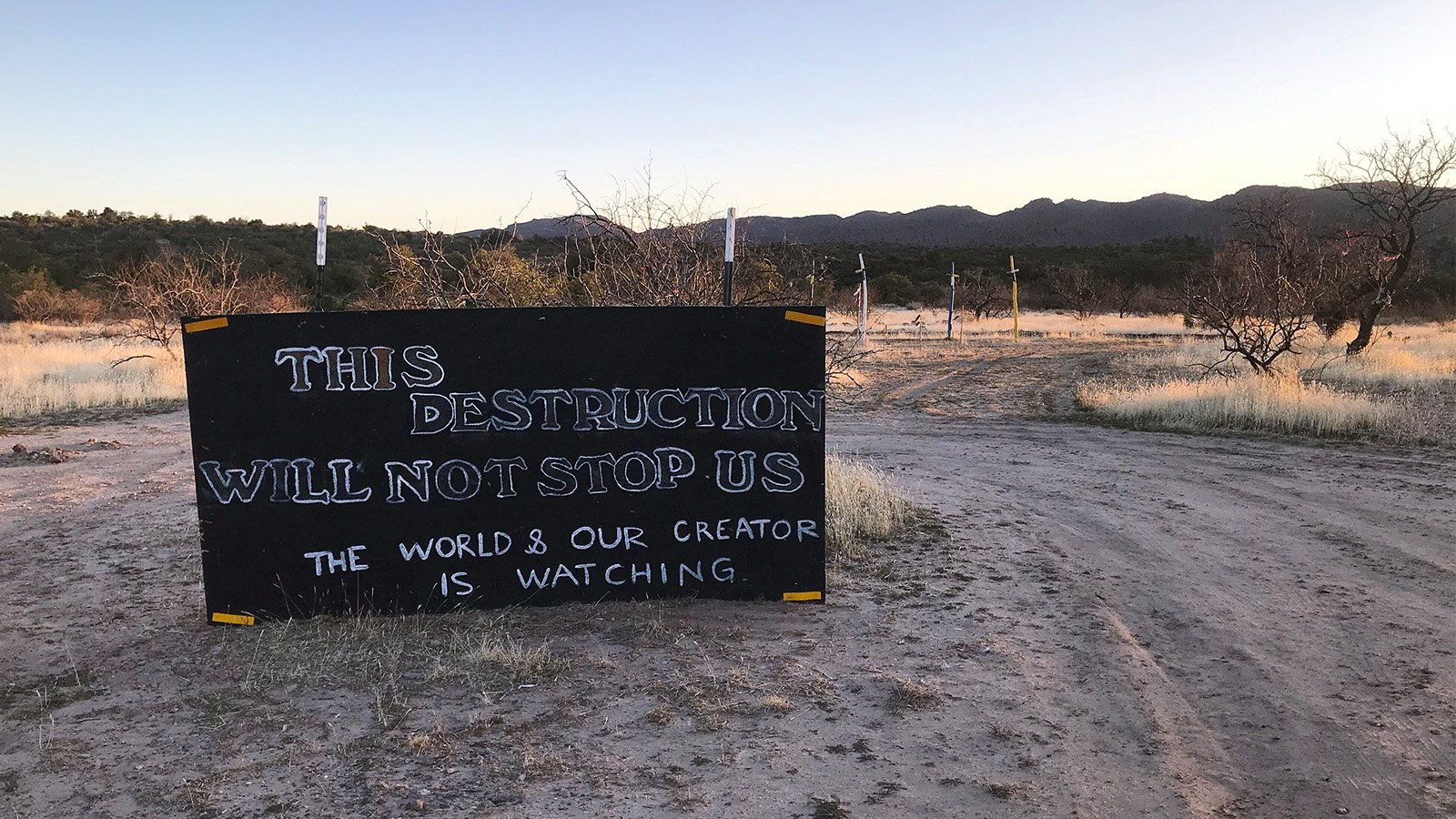 Signs protesting the transfer of Oak Flat stand just outside the Oak Flat campground in Arizona's Tonto National Forest, roughly 70 miles east of Phoenix. RNS photo by Alejandra Molina