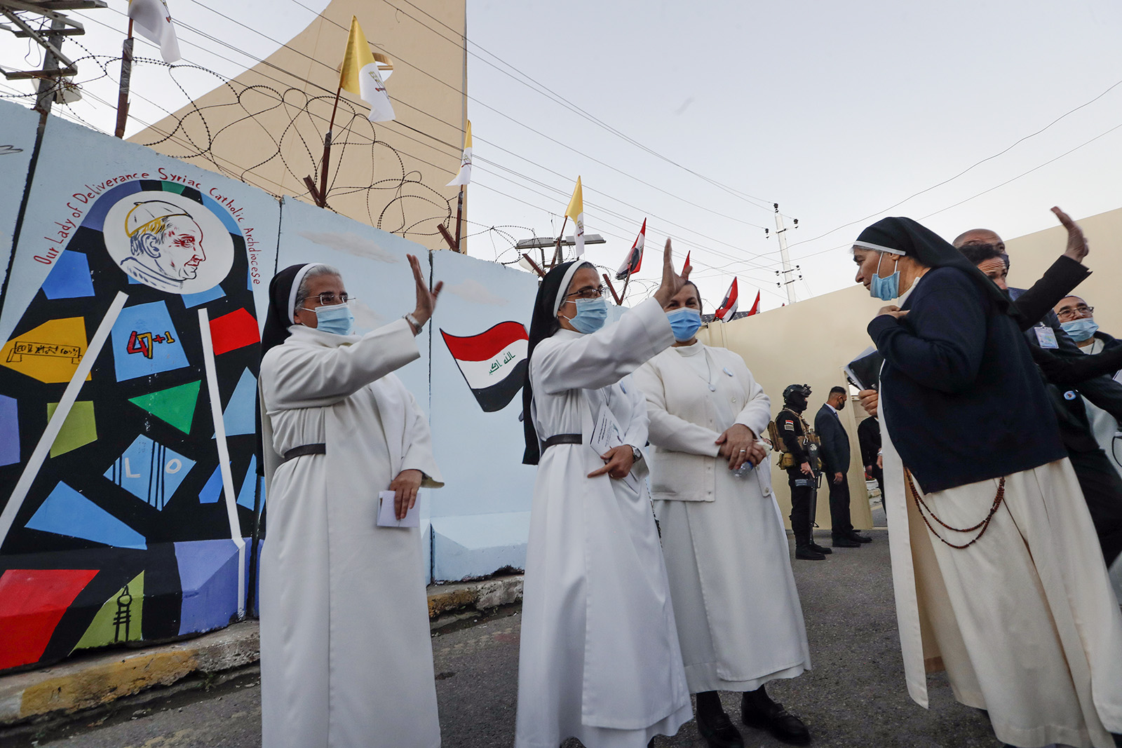 Nuns waves as Pope Francis leaves the Sayidat al-Nejat (Our Lady of Salvation) Cathedral, in Baghdad, Iraq, Friday, March 5, 2021. Pope Francis has arrived in Iraq to urge the country's dwindling number of Christians to stay put and help rebuild the country after years of war and persecution, brushing aside the coronavirus pandemic and security concerns. (AP Photo/Andrew Medichini)