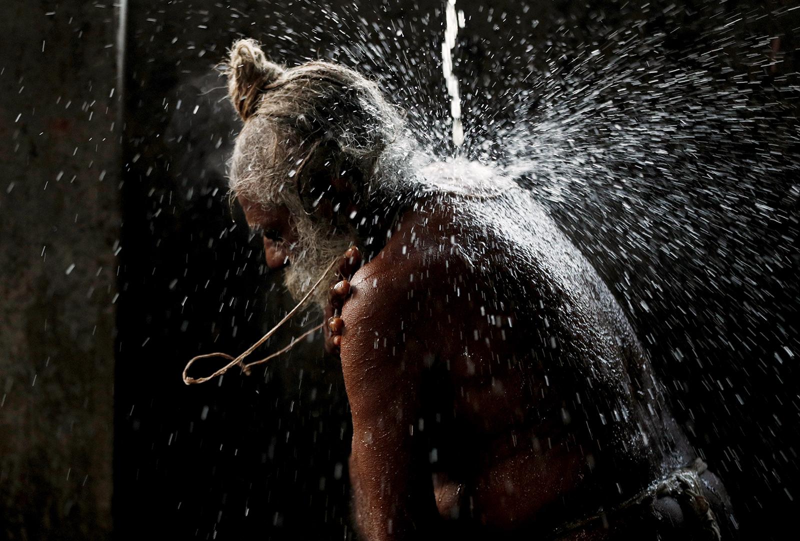 A Hindu holy man takes a holy bath before praying during Shivratri festival on the Pashupatinath temple premises in Kathmandu, Nepal, Thursday, March 11, 2021. Shivratri, or the night of Shiva, is dedicated to the worship of Lord Shiva, the Hindu god of death and destruction. (AP Photo/Niranjan Shrestha)