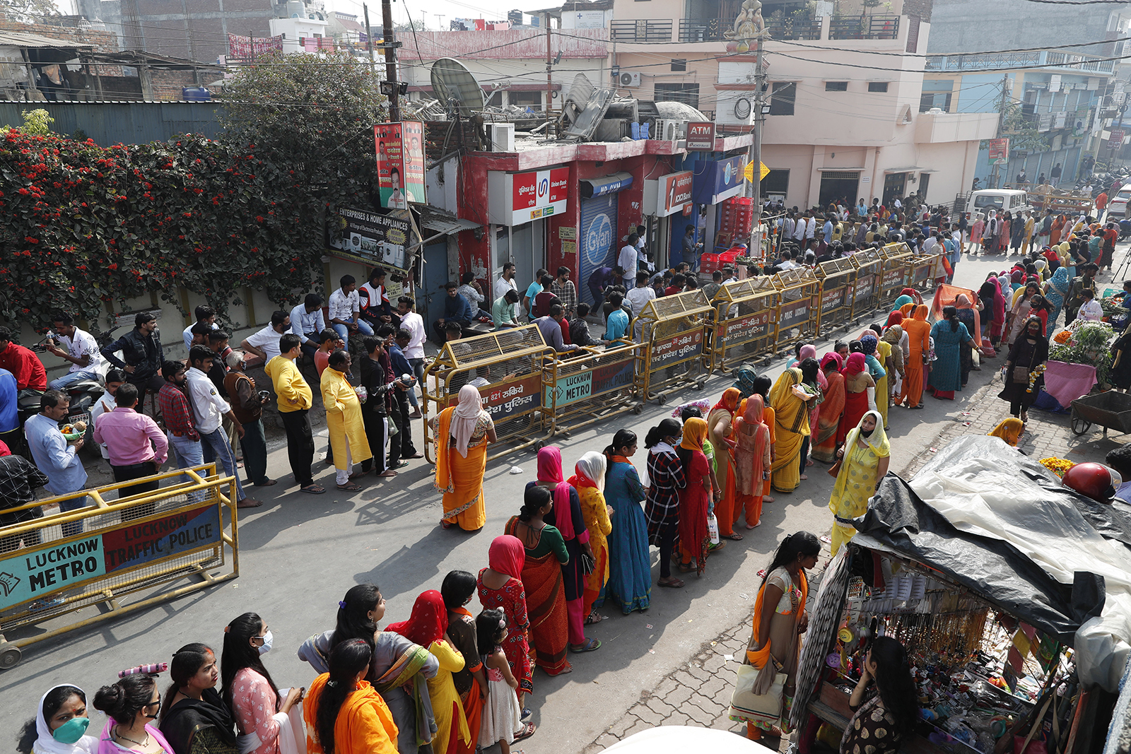 Hindu devotees wait in a line to enter a temple to offer prayers during Shivratri, or Shiva's night festival, in Lucknow, India, Thursday, March 11, 2021. Shivaratri, or the night of Shiva, is dedicated to the worship of Lord Shiva, the Hindu god of death and destruction. (AP Photo/Rajesh Kumar Singh)