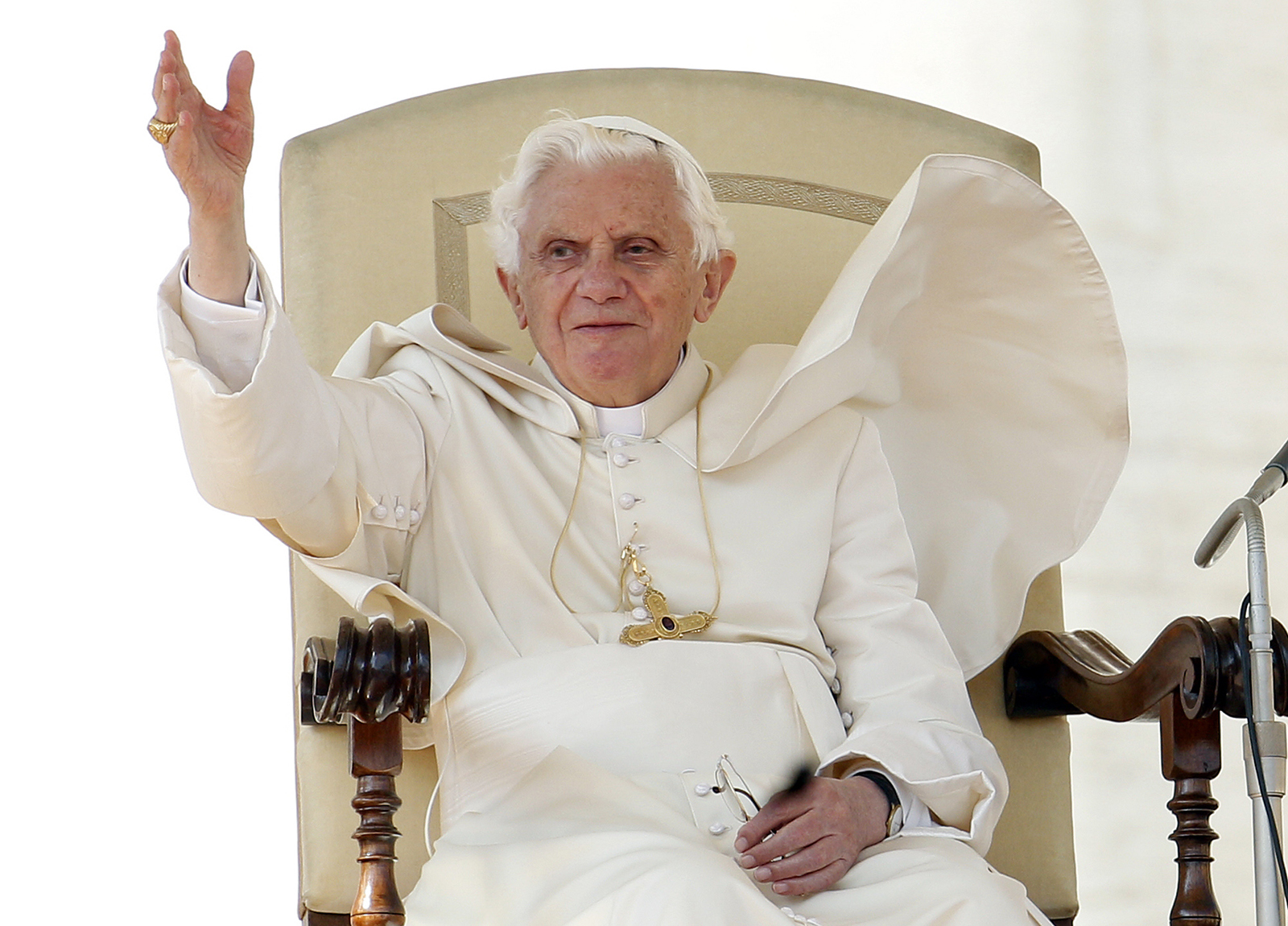 Pope Benedict XVI waves as a gust of wind blows his mantle during a general audience in St. Peter's Square, at the Vatican, Wednesday, Oct. 19, 2011. (AP Photo/Pier Paolo Cito)