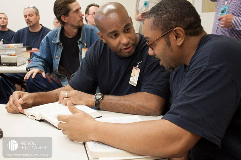 Two men read and discuss the Bible together. Photo courtesy of Prison Fellowship