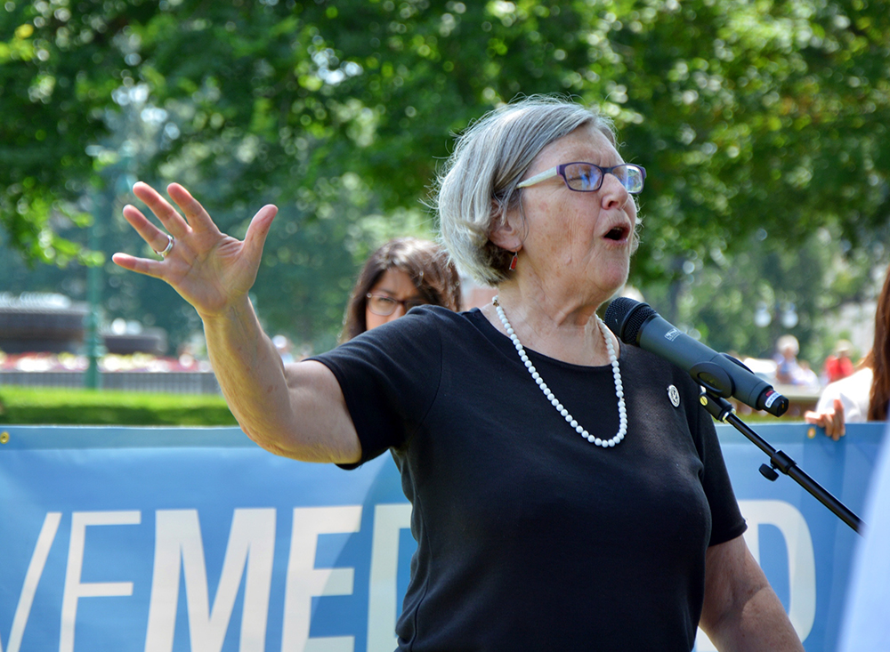 Sister Simone Campbell speaks at a June 2017 protest outside the U.S. Capitol. The protest was against the Republican-led effort to repeal and replace the Affordable Care Act. RNS photo by Jack Jenkins