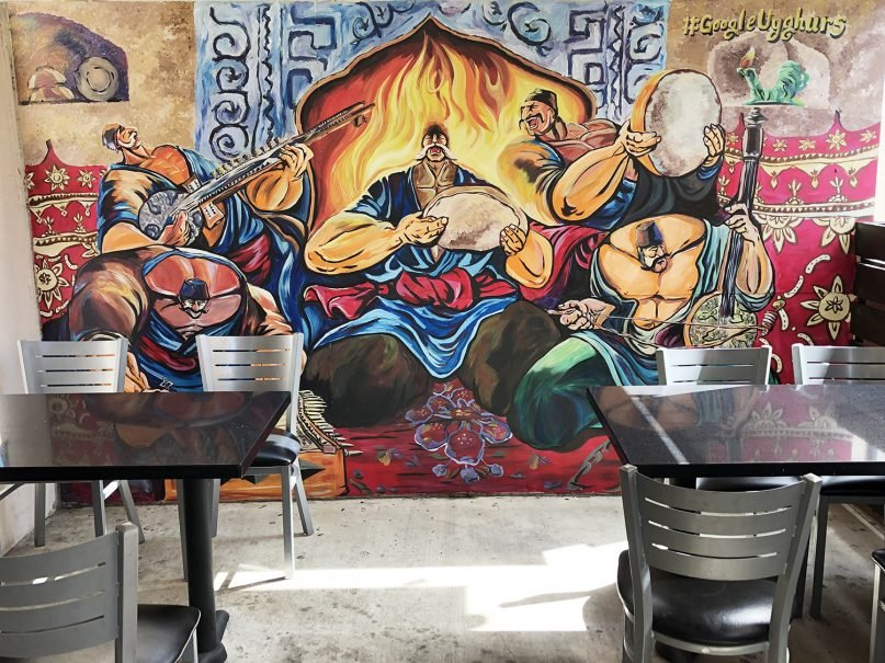 """Dolan's Uyghur Cuisine in Alhambra, California, features a mural including the reminder to """"Google Uyghurs"""" and learn more about the people and their plight. RNS photo by Joseph Hammond"""