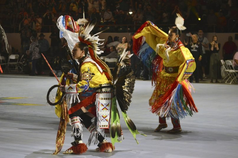 FILE - In this April 27, 2018, file photo, dancers enter at the Gathering of Nations, one of the world's largest gatherings of Indigenous people in Albuquerque, New Mexico. This year's Gathering of Nations is taking place virtually this week as the coronavirus pandemic causes powwows across the U.S. to adapt for a second year. (AP Photo/ Russell Contreras, File)