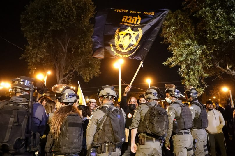 In this Thursday, April 22, 2021 file photo, Israeli border police block members of