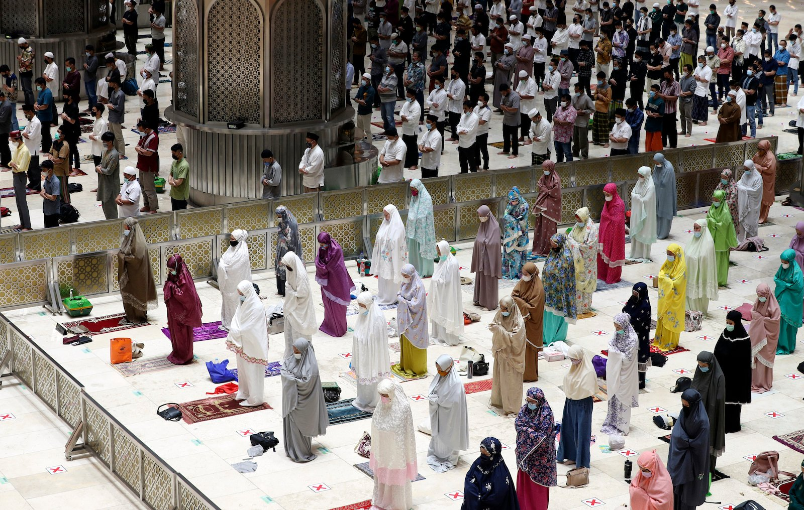 Indonesian Muslims pray while practicing social distancing to curb the spread of the novel coronavirus during an evening prayer called tarawih as they mark the first eve of the holy fasting month of Ramadan at Istiqlal Mosque in Jakarta, Indonesia, on April 12, 2021. During Ramadan, the holiest month in the Islamic calendar, Muslims refrain from eating, drinking, smoking and sex from dawn to dusk. (AP Photo/ Achmad Ibrahim)