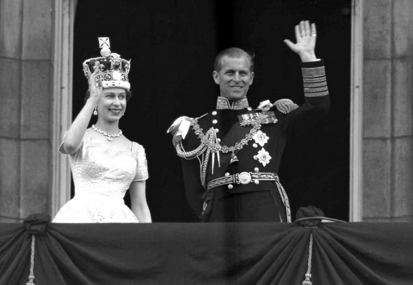 FILE - This is a June. 2, 1953 file photo of Britain's Queen Elizabeth II and Prince Philip, Duke of Edinburgh, as they wave to supporters from the balcony at Buckingham Palace, following her coronation at Westminster Abbey. London.  (AP Photo/Leslie Priest, File)