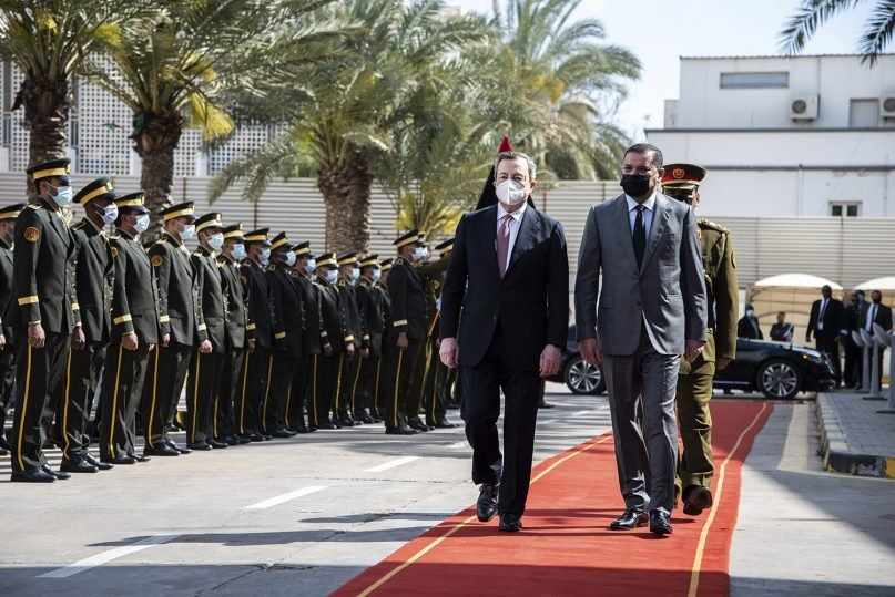 Abdul Hamid Dbeibeh, the Prime Minister of the Government of National Unity, right, welcomes Mario Draghi, the Prime Minister of Italy, Tuesday, April, 6 2021 in Tripoli, Libya. (AP Photo/Nada Harib)