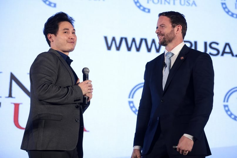 Andy Ngo, left, at a Turning Point USA Teen Student Action Summit in 2019 with U.S. Rep Dan Crenshaw. Photo by Gage Skidmore/Creative Commons