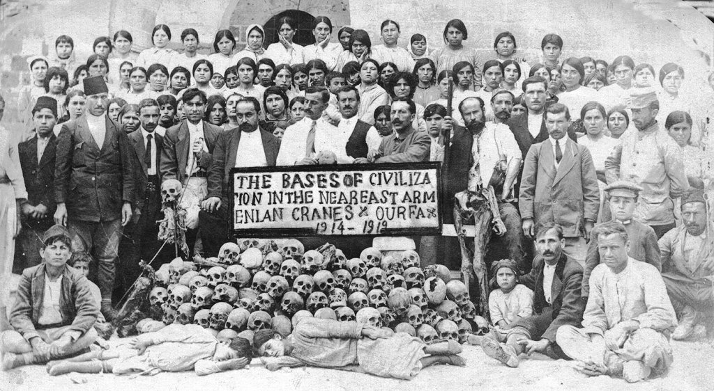 Skulls of Armenians massacred in Urfa, surrounded by Armenian dignitaries and women from the women's shelter in Urfa's Monastery of St. Sarkis, in June 1919. Photo courtesy ABGU/Creative Commons
