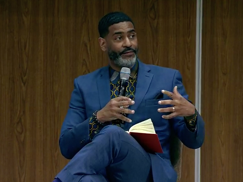 the Rev. Otis Moss III, senior pastor of Trinity United Church of Christ in Chicago, participates in a livestreamed panel, Monday, April 5, 2021, from Apostolic Faith Church in Chicago. Video screengrab