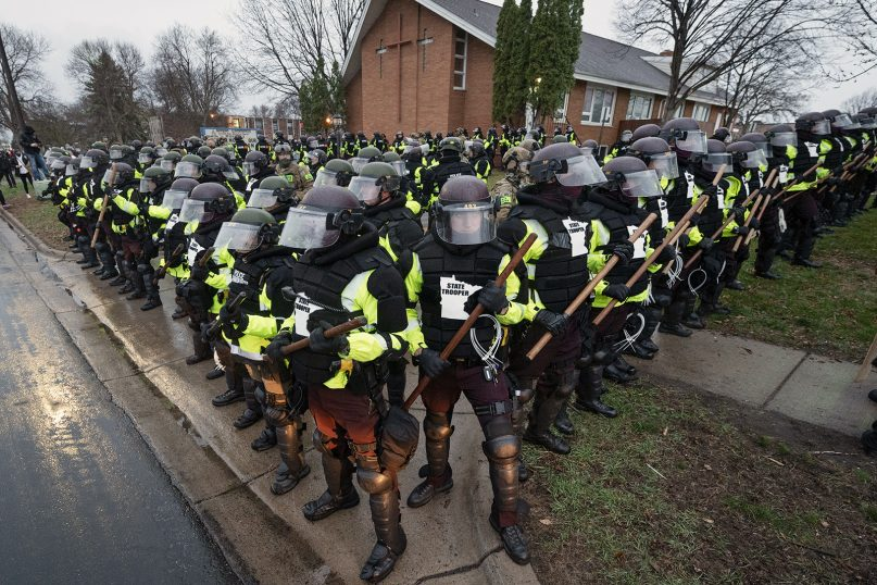 Police stand in formation near Kenyan Community Seventh-day Adventist Church in Brooklyn Center, a suburb of Minneapolis, Monday, April 12, 2021. Daunte Wright was killed in Brooklyn Center on April 11, 2021. Photo by Scott Streble