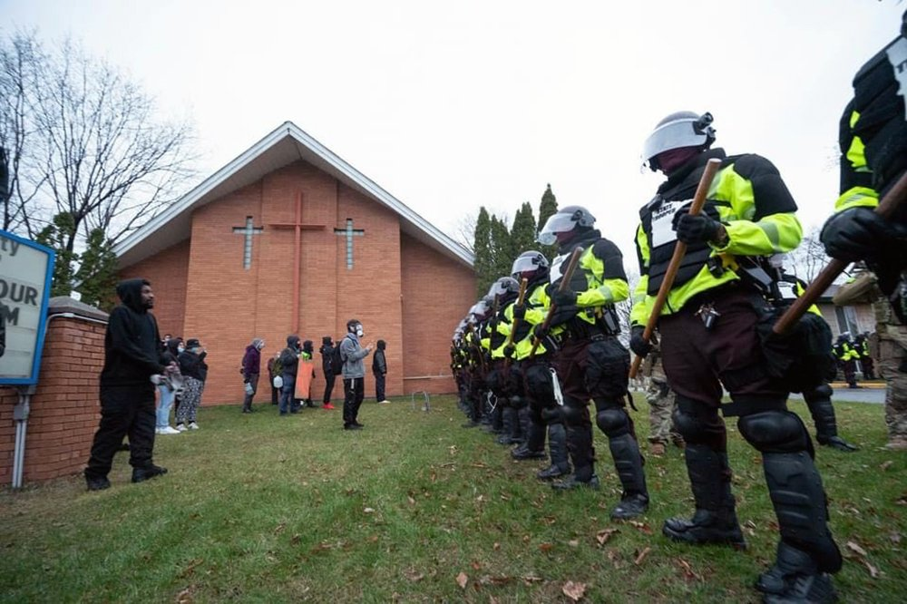 Police stand in formation near Kenyan Community Seventh-day Adventist Church in Brooklyn Center, a suburb of Minneapolis, Monday, April 12, 2021. Photo by Scott Streble