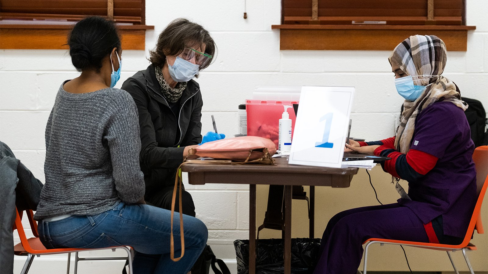 A female patient, left, arrives for the COVID-19 vaccine at a Neighborhood Health vaccination site at Alfred Street Baptist Church in Alexandria, Virginia, April 5, 2021. Photo courtesy of Neighborhood Health