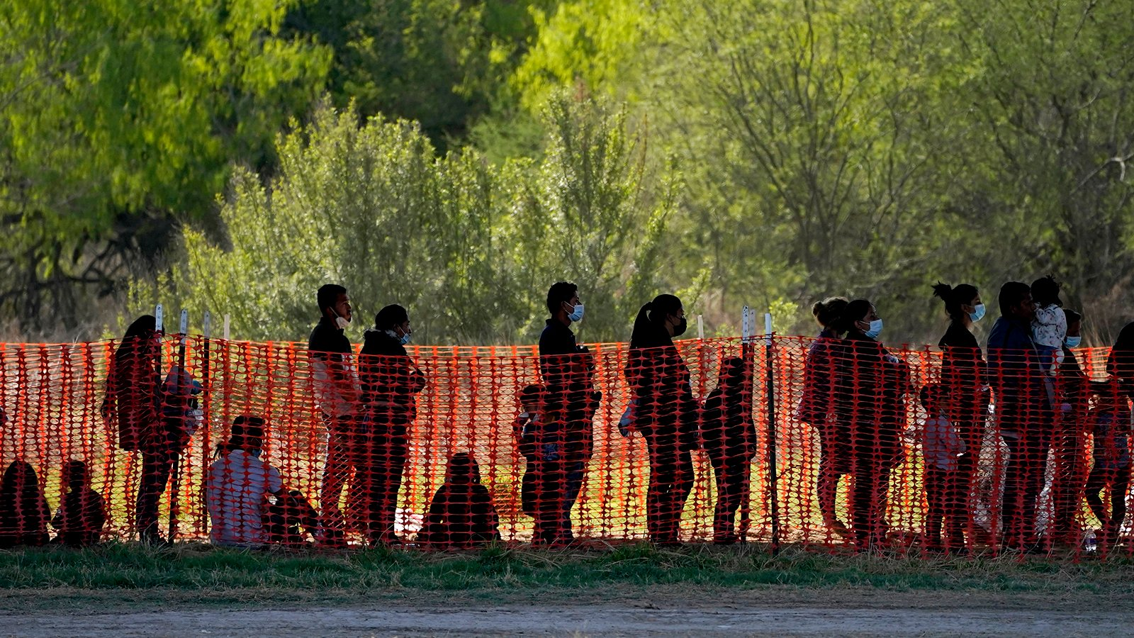 In this March 19, 2021, file photo, migrants are seen in custody at a U.S. Customs and Border Protection processing area under the Anzalduas International Bridge, in Mission, Texas. U.S. authorities say they picked up nearly 19,000 children traveling alone across the Mexican border in March. It's the largest monthly number ever recorded and a major test for President Joe Biden as he reverses many of his predecessor's hardline immigration tactics. (AP Photo/Julio Cortez, File)