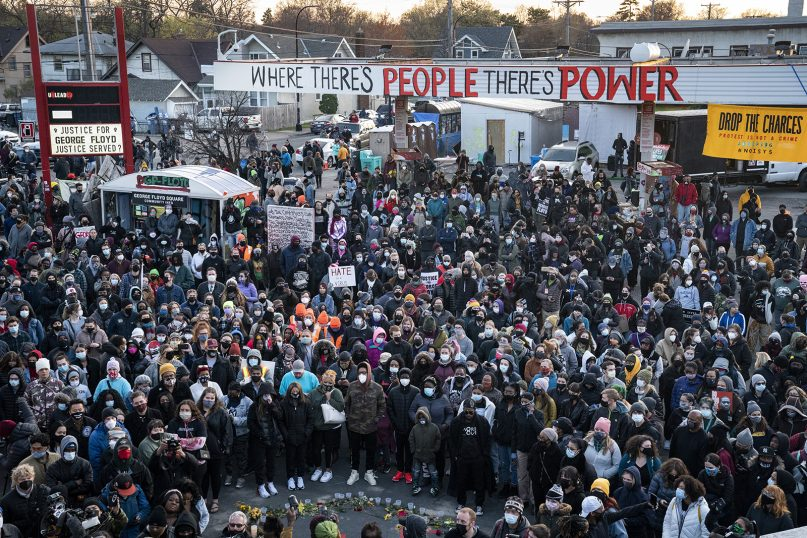 Demonstrators gather outside Cup Foods in Minneapolis on April 20, 2021, to celebrate the murder conviction of former Minneapolis police Officer Derek Chauvin in the killing of George Floyd. (AP Photo/John Minchillo)
