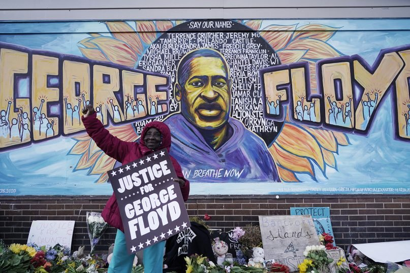 A person reacts near Cup Foods in Minneapolis on April 20, 2021, after a guilty verdict was announced at the trial of former Minneapolis police Officer Derek Chauvin for the 2020 death of George Floyd. Chauvin was convicted of murder and manslaughter in Floyd's death. (AP Photo/Morry Gash)