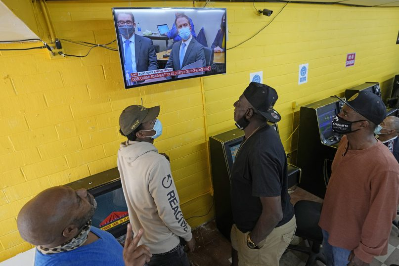 People gather inside a convenience store in the Houston neighborhood where George Floyd grew up, to listen to the verdict in the murder trial against former Minneapolis police Officer Derek Chauvin, April 20, 2021, in Houston. (AP Photo/David J. Phillip)