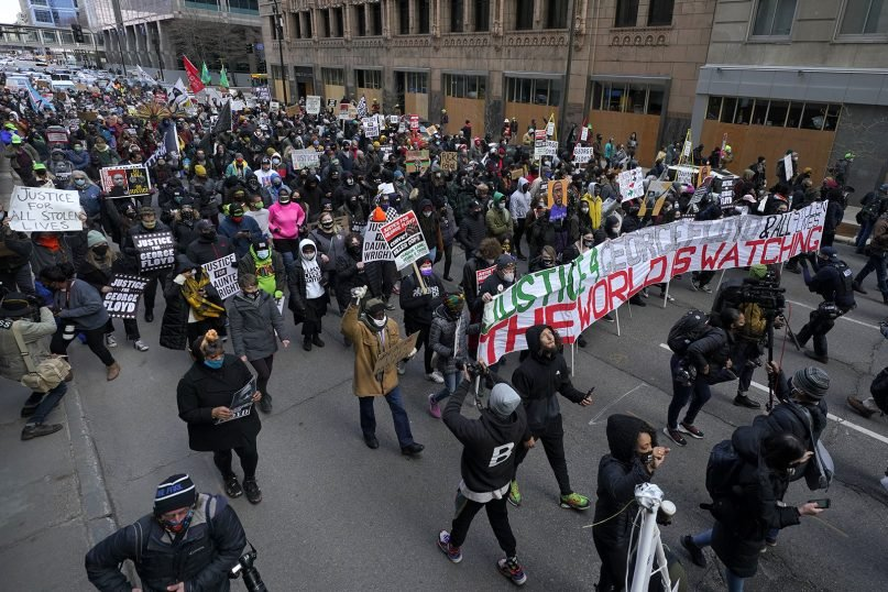 People participate in a rally outside of the Hennepin County Government Center in Minneapolis, Monday, April 19, 2021, after the murder trial against former Minneapolis police officer Derek Chauvin advanced to jury deliberations. (AP Photo/Julio Cortez)