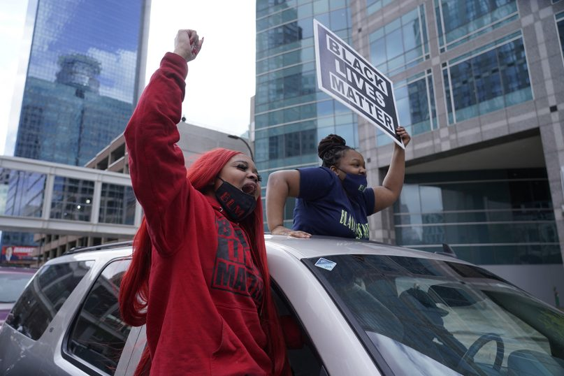 People cheer after a guilty verdict was announced at the trial of former Minneapolis Officer Derek Chauvin for the 2020 death of George Floyd, Tuesday, April 20, 2021, in Minneapolis, Minn. Former Minneapolis Officer Derek Chauvin has been convicted of murder and manslaughter in the death of Floyd. (AP Photo/Morry Gash)