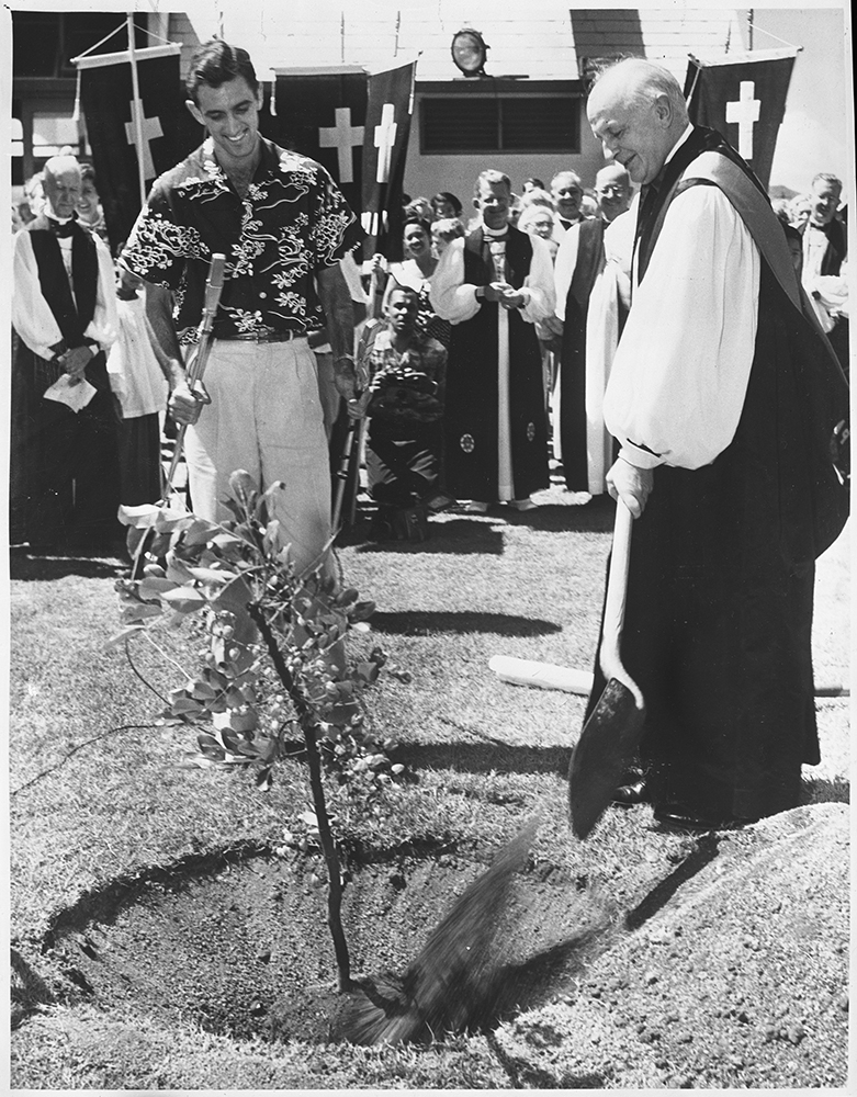 """The Rt. Rev. Henry Knox Sherrill, Presiding Bishop of the Protestant Episcopal Church, plants the """"Presiding Bishop's Tree"""" in Honolulu in 1955, during the church's 58th Triennial General Convention. The Rainbow Shower tree was planted as a living symbol of the Episcopal Chruch. It was one of 43 trees forming an avenue of shower trees. RNS archive photo. Photo courtesy of the Presbyterian Historical Society"""