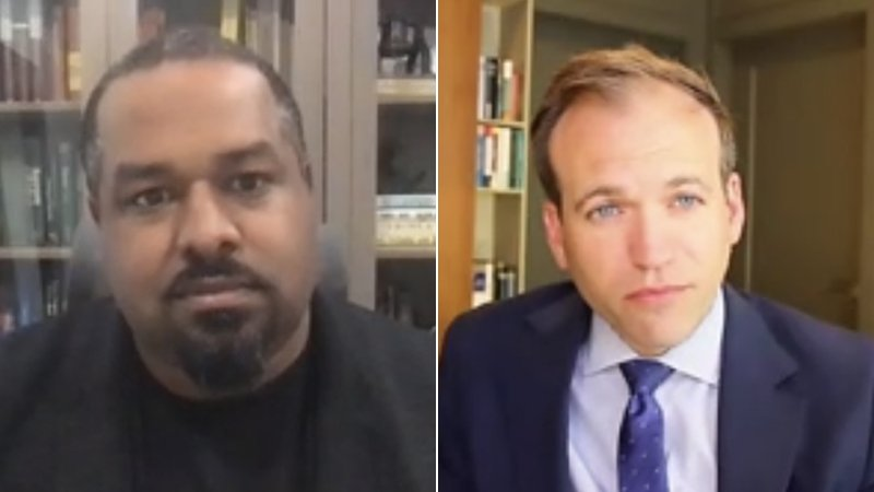 """Joshua DuBois, left, and the Rev. Johnnie Moore participate in the """"Unpacking the Role of a Faith Adviser"""" panel during a virtual Religion News Association conference, April 22, 2021. Video screengrab"""