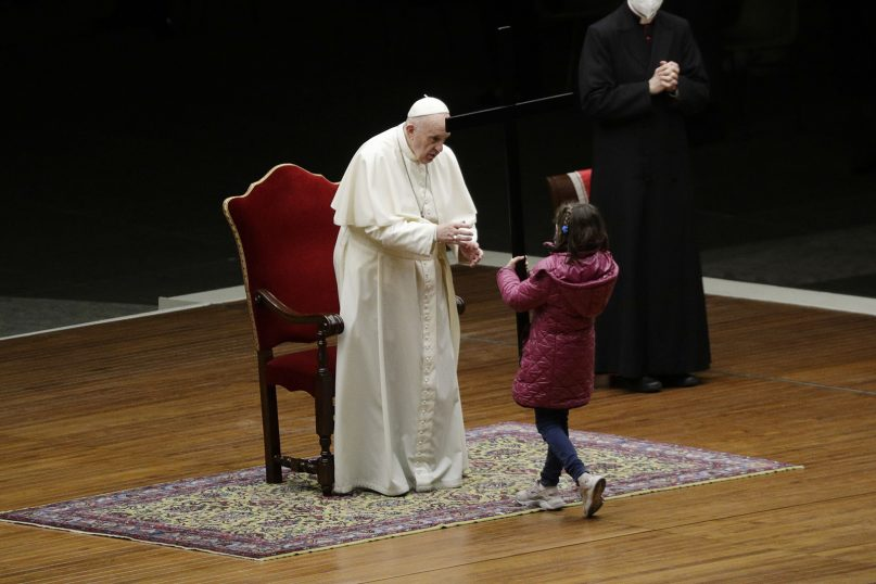 Pope Francis presides over the Via Crucis (Way of the Cross) ceremony with children in St. Peter's Square, at the Vatican, Friday, April 2, 2021. (AP Photo/Gregorio Borgia, Pool)