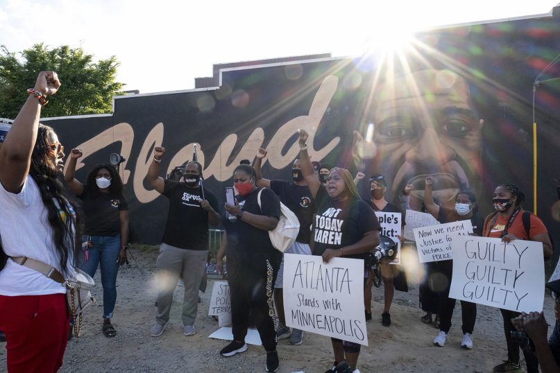 People gather before a march in Atlanta, on April 20, 2021, after former Minneapolis police Officer Derek Chauvin was found guilty on all counts in the death of George Floyd. (AP Photo/Ben Gray)
