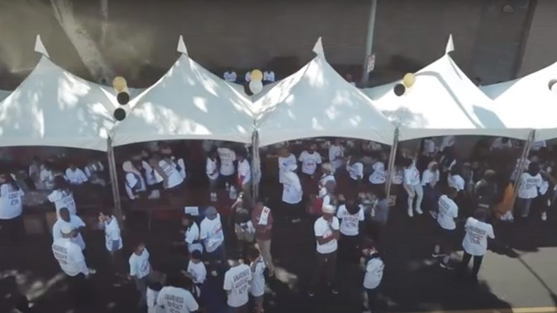 People work together during a pre-COVID Humanitarian Day event in Southern California. Video screengrab