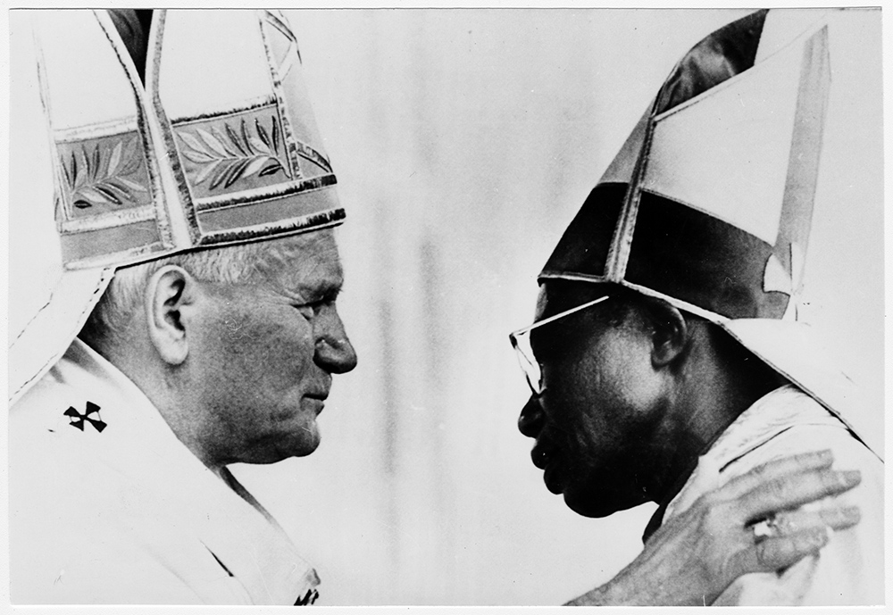 Pope John Paul II, left, embraces one of eight new African bishops he ordained at Kinshasa, Zaire [Democratic Republic of the Congo], in May 1980. RNS archive photo. Photo courtesy of the Presbyterian Historical Society